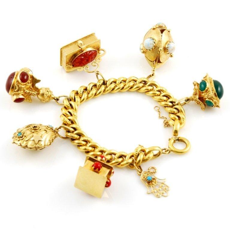 bracciale oro con charms