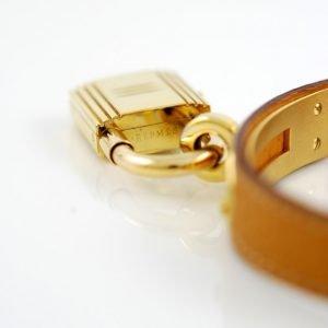 Hermes orologio lucchetto Kelly placcato oro e bracciale in pelle